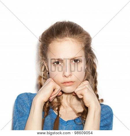 Girl With Two Hands In Fists, Face Contorted In Anger