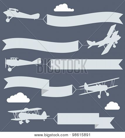 Silhouettes of biplanes with wavy greetings banner