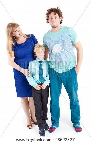 Mom And Dad Grimacing While Son Looking At Camera, Isolated On White Background