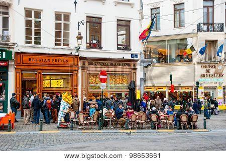 People Eating Traditional Belgian Frites In Brussels