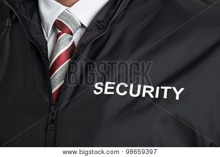 Security Guard Wearing Uniform With The Text Security