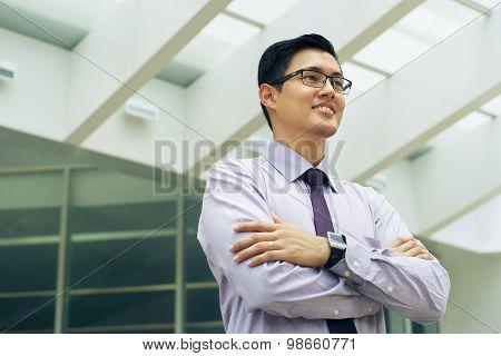 Portrait Chinese Businessman Contemplating Office Skyscraper