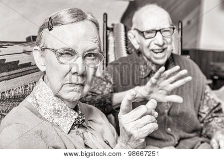 Toned Image Of Angry Old Couple In Livingroom