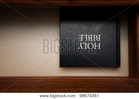 Holy Bible book in a open drawer upside down poster