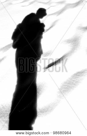 Shadow Of A Man With Hat And Backpack