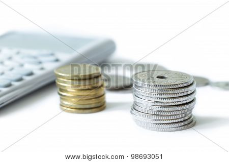 Stack Of Money With Calculator Isolated On White Background