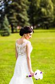 Beautiful bride in wedding dress and bridal bouquet, happy newlywed woman with wedding flowers, woman with wedding makeup and hairstyle. gorgeous young bride outdoors. Bride waiting for groom. bride poster