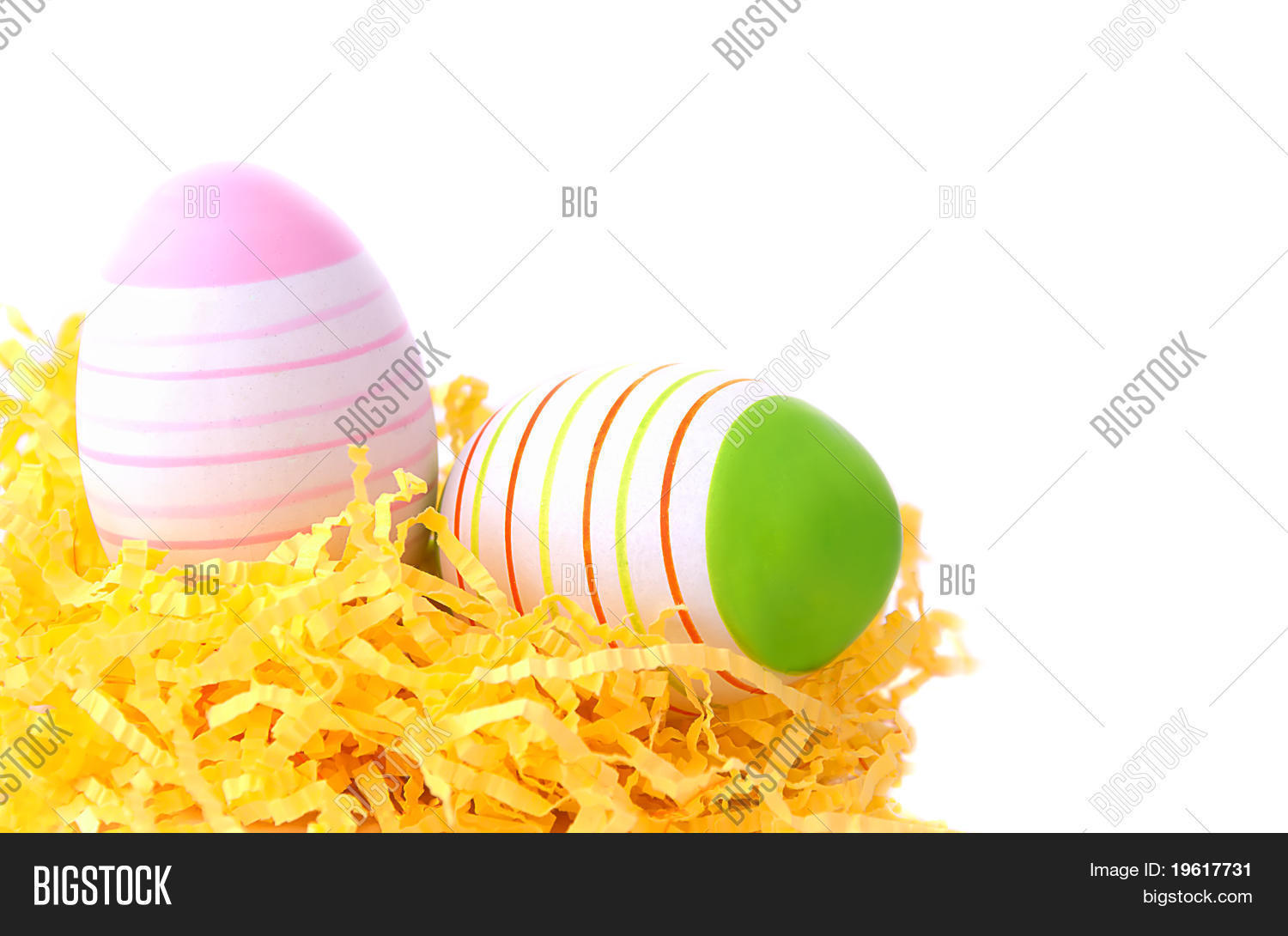 Two Easter Eggs In Yellow Nest