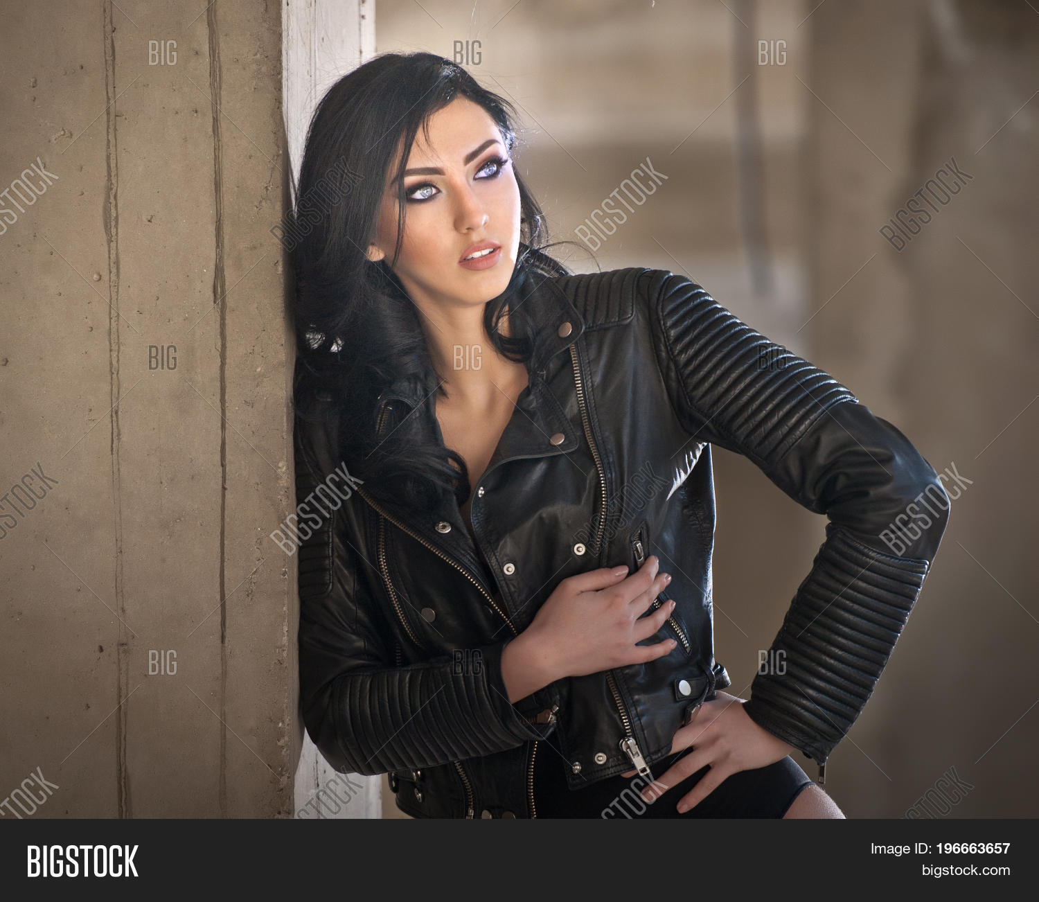 45c2a9b8d85 Portrait of beautiful sexy young woman with black outfit, leather jacket  over lingerie, in