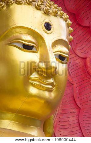 Close up the face of beautiful buddha with King naga Mujarin at Wat BuraphaUbonratchathani ProvinceThailand.