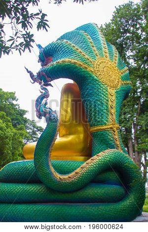 Backside of beautiful buddha with King naga Mujarin at Wat BuraphaUbonratchathani ProvinceThailand.