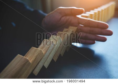 Problem Solving Close Up View On Hand Of Business Woman Stopping Falling Blocks On Table For Concept