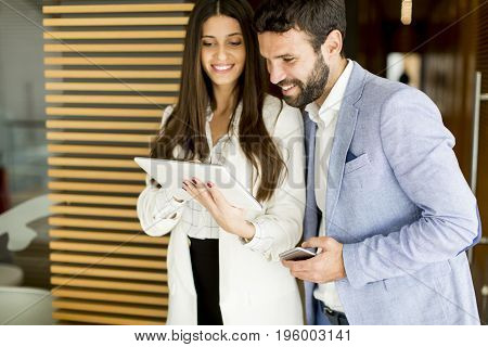Young Bussiness Couple In The Office