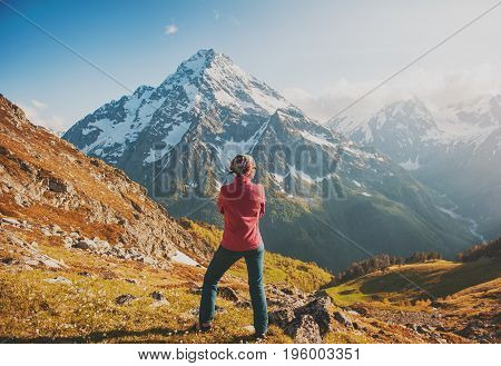 Woman Hiker Standing On The Top Of Mountain. Back Pose
