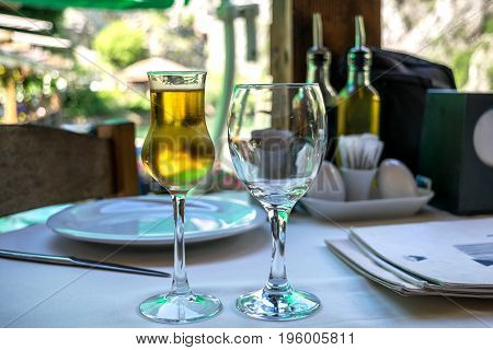 Fruit brandy or schnapps in a frosty glass on a dinner table at the restaurant