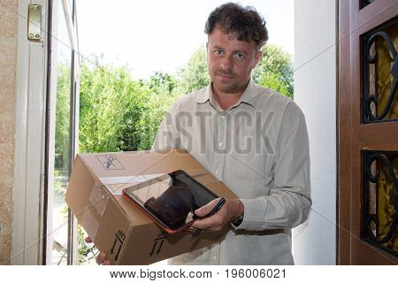 Delivery, Mail, People And Shipping Concept - Happy Man With Tablet Pc Computer And Parcel Boxes At