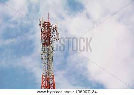 telecommunication mast TV antennas wireless technology under blue sky with cloud