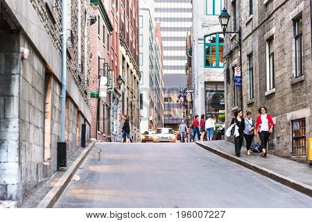 Montreal, Canada - May 27, 2017: Old Town Area With People Walking Up Street In Evening In Quebec Re