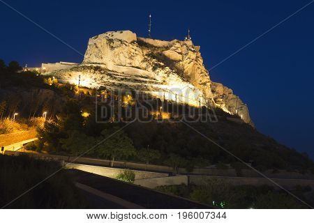 Castle of Santa Barba illuminated at night in the city of Alicante Comunidad Valenciana Spain.