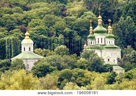 Image Orthodox church with golden domes and green roof