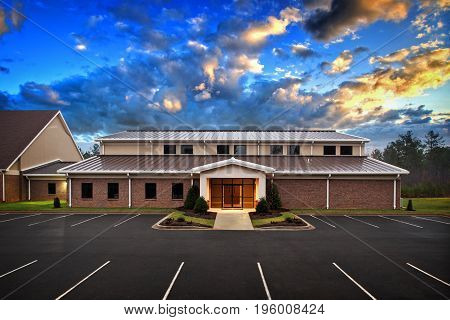 Generic Small Office Executive Building Exterior With Powerful Sky