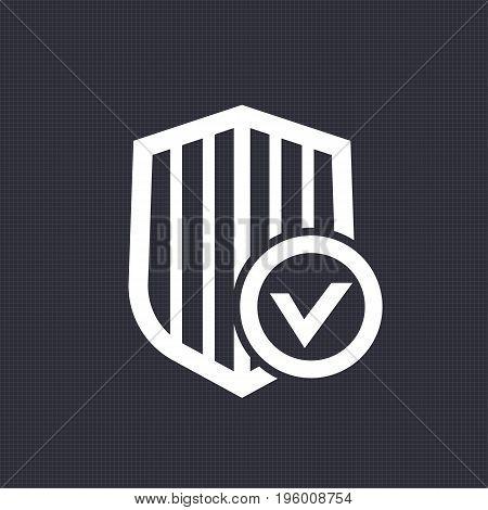 Shield with check mark icon over dark