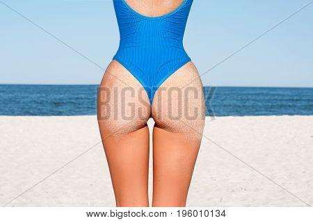 Sexy Sandy Woman Buttocks On Tropical Beach Background Near Ocean.