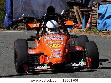 Malvaro Favale Italy - July 16 2017: Uphill Race Race Favale Castello: The F1 racing car type L.R. Conducted Roberto Loda in action on the path