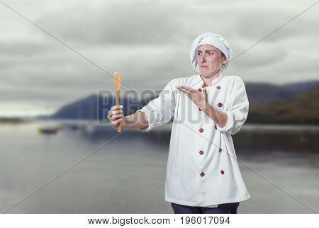 Crazy Young Woman Chef Is Speaking With Wood Spoon