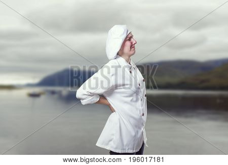 Young Woman Chef Has Back Pain. She Is Suffer