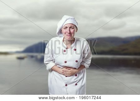 Young Woman Chef Has Stomach Pain. She Is Suffer