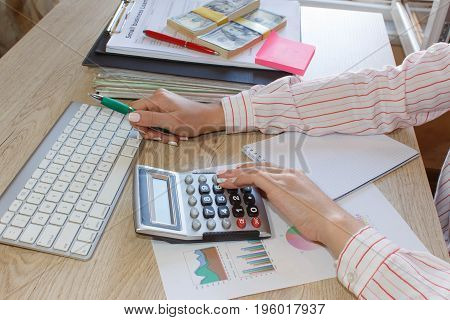 Business woman working with form documents with money. Home finances investment economy saving money or insurance concept