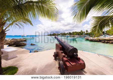 Ship cannon on the embankment of the city of Bayahibe La Altagracia Dominican Republic. Copy space for text