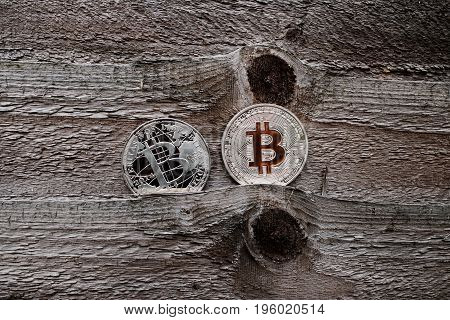Silver Bitcoins On Wooden Background