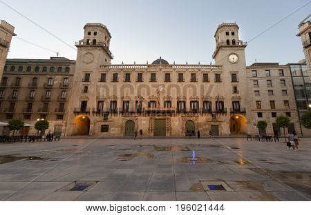 Alicante, Spain. July 10, 2017: Town Hall Square of the City of Alicante at nightfall, in the Valencian community, Spain.
