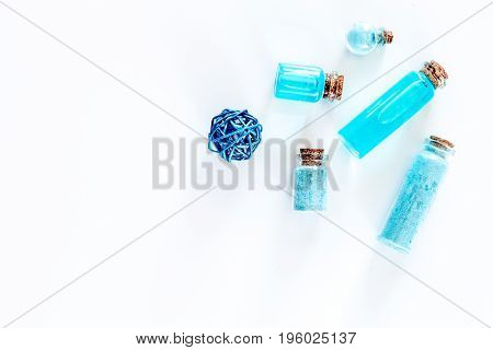 Sea cosmetics. Sea salt, blue clay and lotion on white background top view.