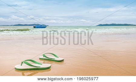 Thai style foam sandals on the beach