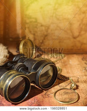 Ancient World Map With A Variety Of Accessories. Vintage Still Life. Travel Concept