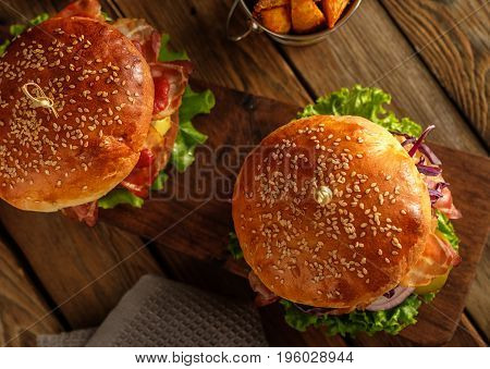 Two Delicious Homemade Hamburgers On Wooden Table.top View