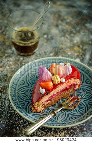 A Slice Of Cake With Cream And Fresh Fruit On A Plate. Cake And A Glass Of Coffee On The Table