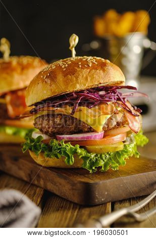 Delicious Fresh Hamburger With Meat, Cheese And Vegetables On Wooden Board