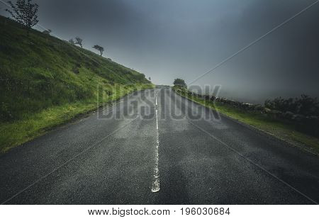 Empy Asphalt Road in Mist Snowdonia National Park UK