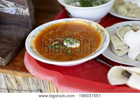 Plates With Soup And Pelmeni