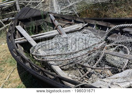 Details of old fishing boat with nets