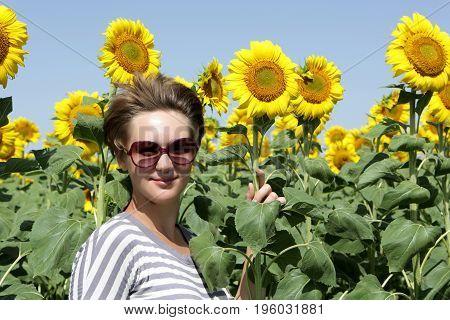 Woman Among Sunflowers