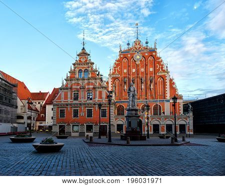 RIGA LATVIA - JUNY 03 2017: City Hall Square with House of the Blackheads in Old Town of Riga in the morning Latvia