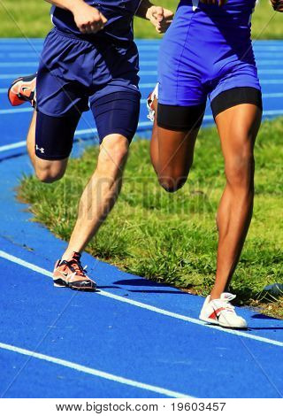 two male runners competing