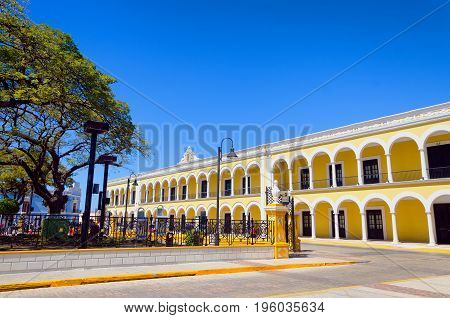 Yellow colonial building in street on the main plaza in Campeche Mexico