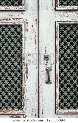 Ancient white painted wooden door of a residence