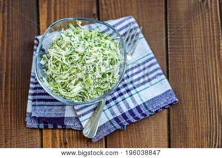 Cabbage salad and spices. Copy space. The concept is healthy food diet vegan.